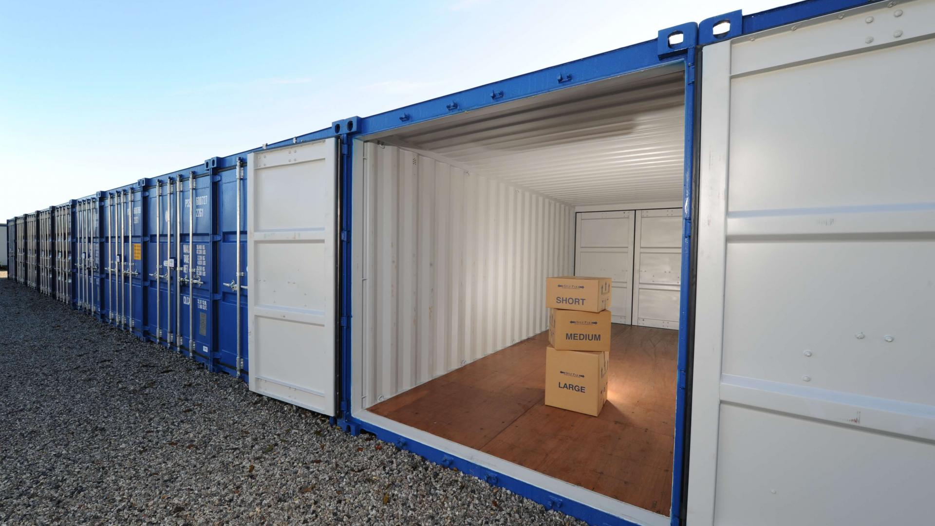 Row of storage containers with boxes inside